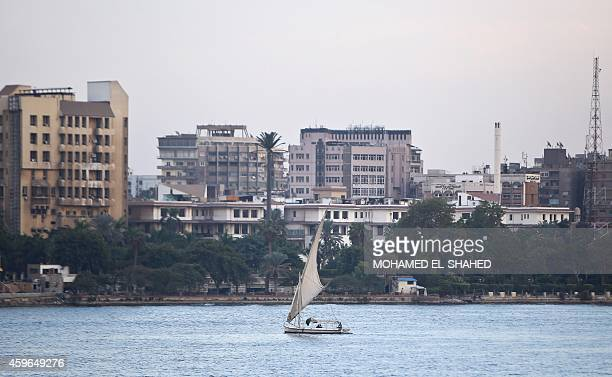 A faluka boat sails on Egypt's Nile river in Cairo on November 27 2014 Falling tourist revenues and slowing investments have left Egypt's economy in...