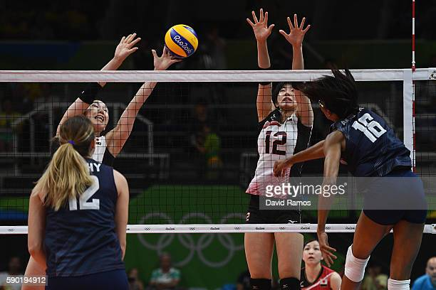 Faluke Akinradewo of The United States pikes the ball past Yuki Ishii of Japan during the Women's Quarterfinal match between Japan and The United...