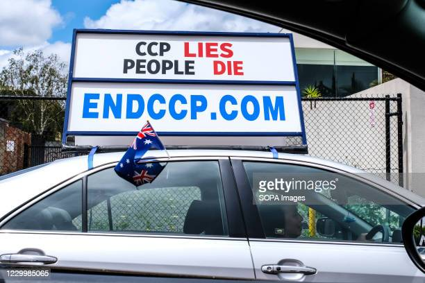 """Falun Dafa or Falun Gong follower seen promoting anti-Chinese Communist Party movement through a display board on his vehicle reading """"ENDCCP.COM"""" in..."""