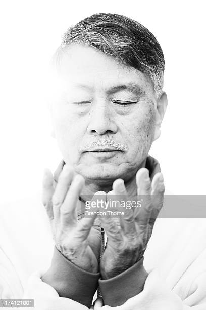 A Falun Gong Practitioner poses on the 14th anniversary of the beginning of the persecution of Falun Gong in China on July 21 2013 in Sydney...