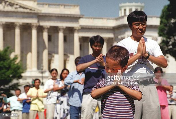 Falungong followers meditate 29 July outside the US Capitol in Washington DC The group received assurances from the US State Department that they...