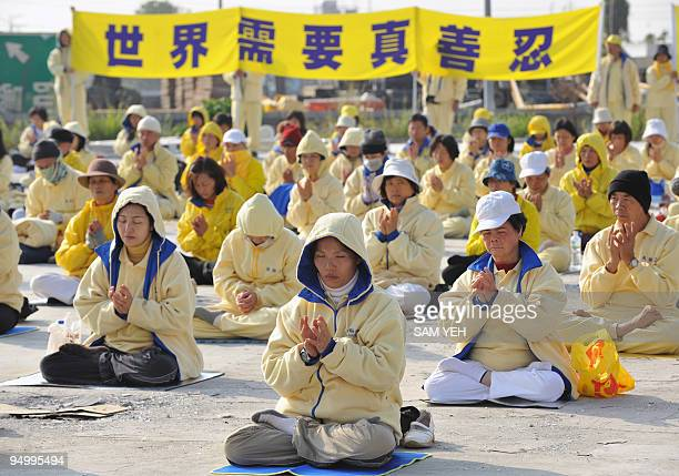 Falungong members practice on the ground outside of the Windsor hotel which are holding the Taiwan and China talks in the central Taichung city on...