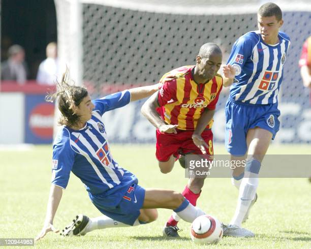 Falvio Conceicao is caught between Areias and Pepe during their USA tour game Galatasaray beats FC Porto 21 during the Championsworld Series USA Tour...