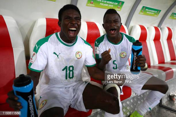 Faly Ndaw of Senegal and Souleymane Aw of Senegal celebrate following their sides victory in the 2019 FIFA U-20 World Cup Round of 16 match between...