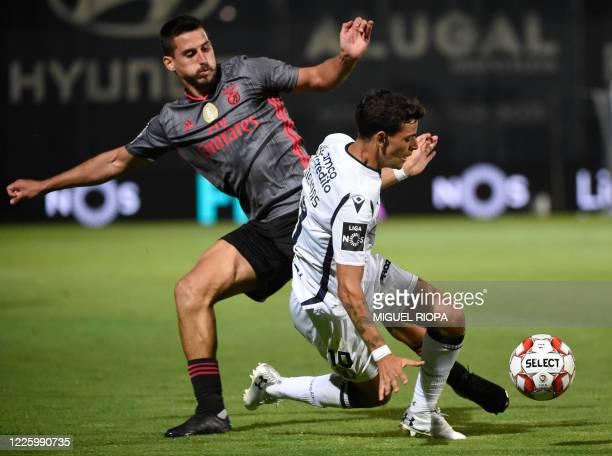 Famalicao's Portuguese forward Ruben Lameiras challenges Benfica's Brazilian midfielder Gabriel during the Portuguese League football match between...