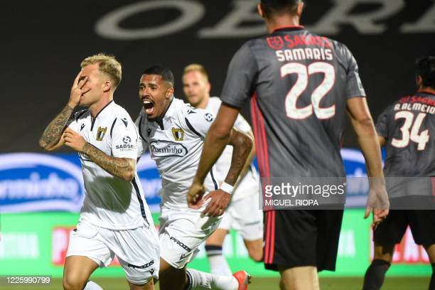 Famalicao's Portuguese midfielder Guga celebrates after scoring a goal during the Portuguese League football match between Famalicao and Benfica at...