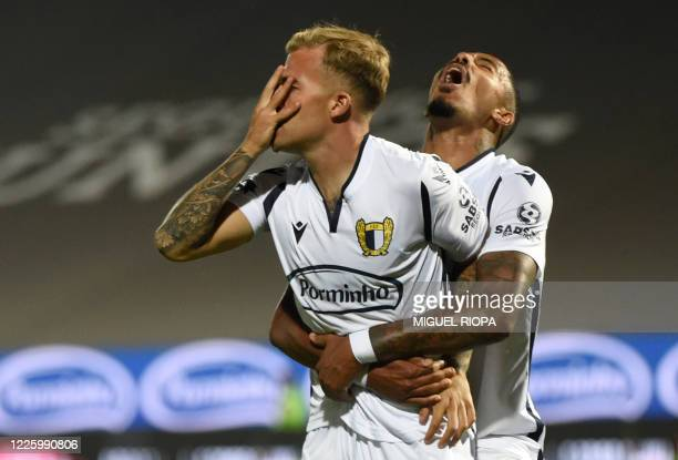 Famalicao's Portuguese midfielder Guga celebrates with Famalicao's Brazilian forward Walterson after scoring a goal during the Portuguese League...