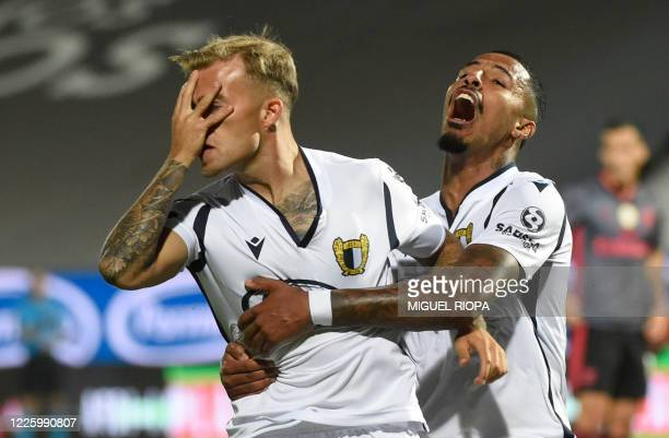 TOPSHOT Famalicao's Portuguese midfielder Guga celebrates with Famalicao's Brazilian forward Walterson after scoring a goal during the Portuguese...