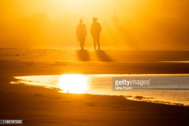 famara beach silhouette - isla de lanzarote fotografías e imágenes de stock