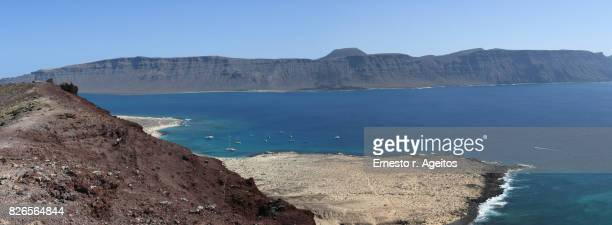 Famara cliffs and La Graciosa island coastline viewed from Montaña Amarilla