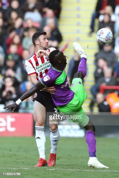 Famara Diédhiou of Bristol City keeps the ball away from Enda Stevens of Sheffield United during the Sky Bet Championship match between Sheffield...