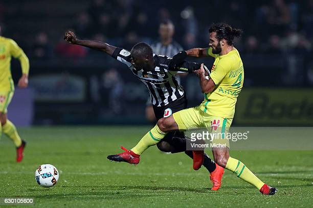 Famara Diedhiou of Angers and Oswaldo Vizcarrondo of Nantes during the French Ligue 1 match between Angers and Nantes on December 16 2016 in Angers...