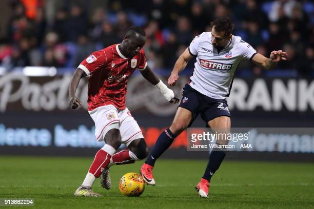 Famara Diedhiou of Bristol City and Filipe Morais of Bolton Wanderers during the Sky Bet Championship match between Bolton Wanderers and Bristol City...