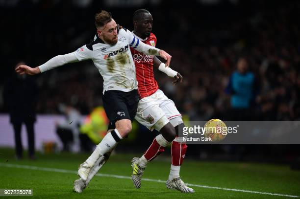 Famara Diedhiou of Bristol City and Richard Keogh of Derby County battle for the ball during the Sky Bet Championship match between Derby County and...