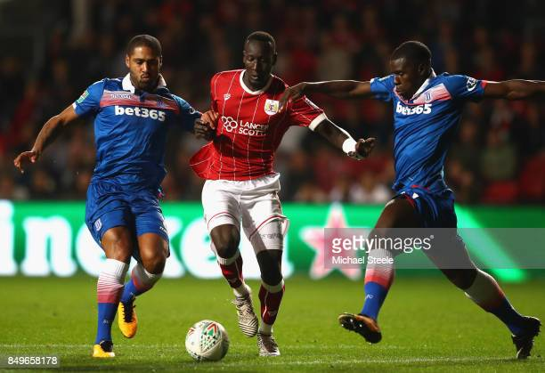 Famara Diedhiou of Bristol City attempts to keep possession while under pressure from Glen Johnson of Stoke City and Kurt Zouma of Stoke City during...