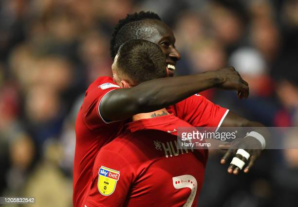 Famara Diedhiou of Bristol City celebrates after scoring his sides third goal with Jack Hunt of Bristol City during the Sky Bet Championship match...