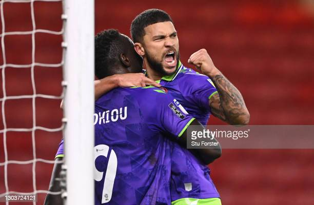 Famara Diedhiou of Bristol City celebrates after scoring their sides second goal with team mate Nahki Wells during the Sky Bet Championship match...