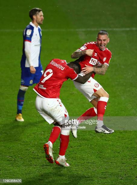 Famara Diedhiou of Bristol City celebrates his goal with teammate Jack Hunt during the Sky Bet Championship match between Bristol City and Blackburn...