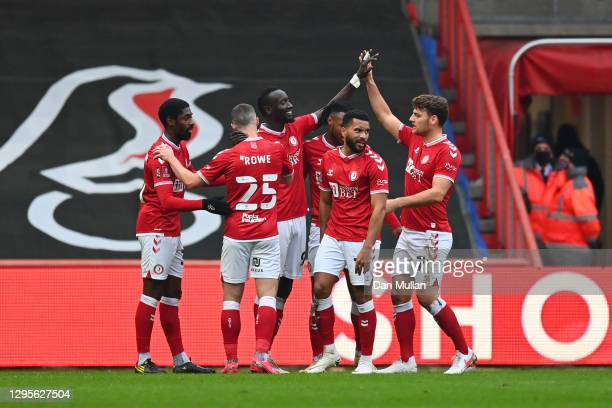Famara Diedhiou of Bristol City celebrates with Chris Martin and team mates after scoring their side's first goal during the FA Cup Third Round match...