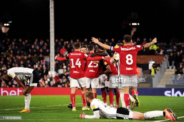 Famara Diedhiou of Bristol City celebrates with teammates after scoring his team's second goal during the Sky Bet Championship match between Fulham...