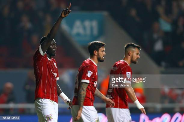 Famara Diedhiou of Bristol City celebrates with teammates after scoring the opening goal during the Sky Bet Championship match between Bristol City...