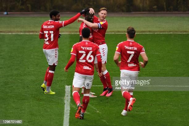 Famara Diedhiou of Bristol City celebrates with teammates Hakeeb Adelakun, Tomas Kalas, Zak Vyner and Chris Martin after scoring his team's first...