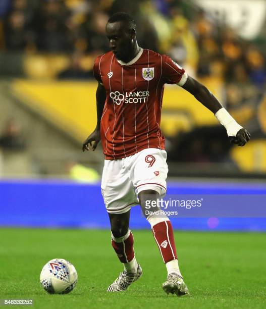 Famara Diedhiou of Bristol City runs with the ball during the Sky Bet Championship match between Wolverhampton Wanderers and Bristol City at Molineux...