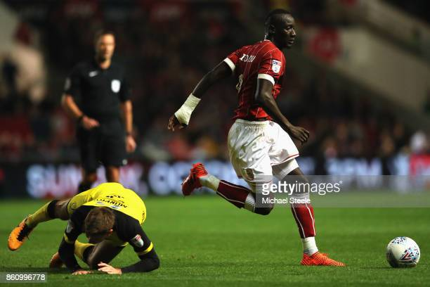 Famara Diedhiou of Bristol City skips past the challenge of Luke Murphy of Burton during the Sky Bet Championship match between Bristol City and...