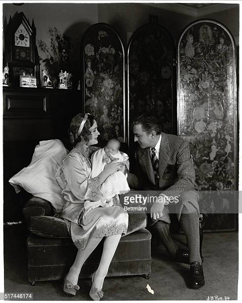 Famed actor John Barrymore looks lovingly at his wife actress Dolores Costello and their new baby Dolores Ethel Barrymore They are seated in a...