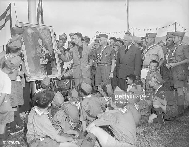 Famed artist Norman Rockwell, is shown pointing to his original painting of George Washington, as Chief Scout Executive Dr. Arthur A. Shuck, Vice...