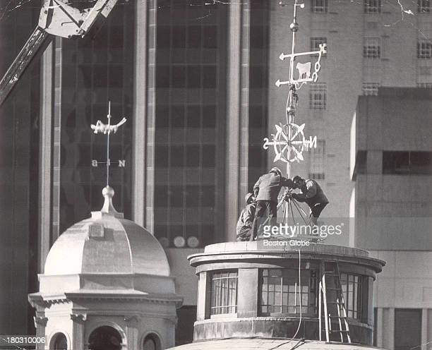 Famed grasshopper atop Boston's historic Faneuil Hall background got a new neighbor as workmen installed a new weathervane on the domed roof of the...