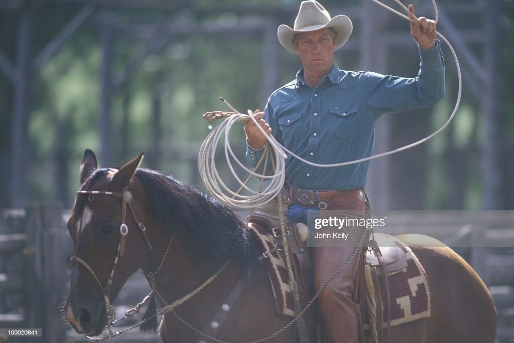 Famed horse trainer Buck Brannaman winds up his lasso during the filming of 'The Horse Whisperer' in 1997.