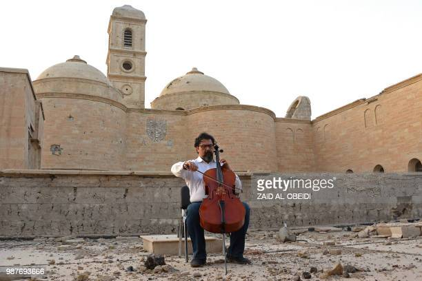 Famed Iraqi maestro and cello player Karim Wasfi performs in front of the Roman Catholic Church of Our Lady of the Hour in Mosuls warravaged Old City...