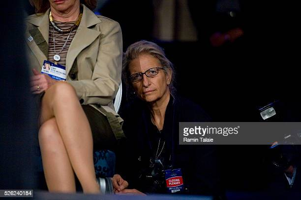 Famed portrait photographer, Annie Leibovitz tries to hide from being photographed during the 2009 Clinton Global Initiative Annual Meeting, Friday,...
