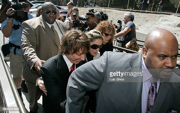 Famed record producer Phil Spector is all smiles while leaving the Los Angeles Criminal Courts Building on Wednesday Sept 26 after his trial for the...