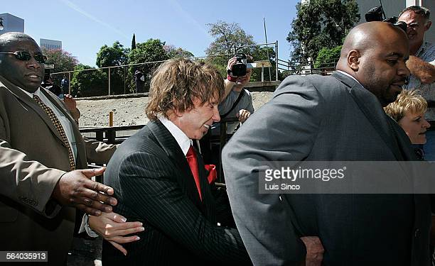 Famed record producer Phil Spector is all smiles while leaving the Los Angeles Criminal Courts Building on Wednesday, Sept. 26 after his trial for...