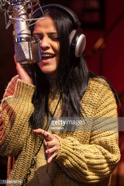 Famele singer performing for recording in sound studio