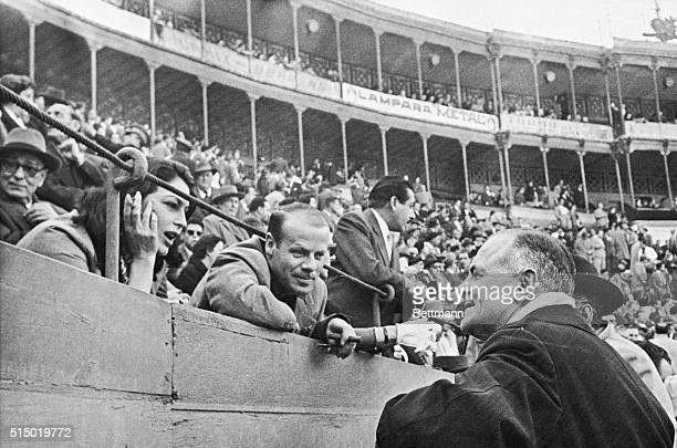 A familiar figure in the choice seats at Spanish bullfights is actress Ava Gardner Here she chats with U S Ambassador John Davis Lodge right at...