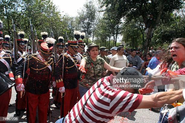 Familiares de victimas de la guerra lanzan pintura roja a soldados del Ejercito de Guatemala que con un desfile conmemoran el 136 aniversario de su...