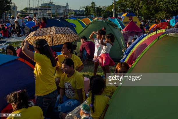 Families and devotees flock to a local park where the procession of the Black Nazarene will start on January 8 2019 in Manila Philippines The Black...