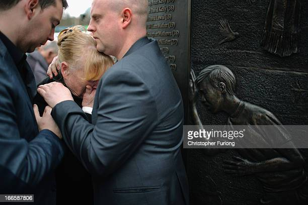 Families and friends of the victims of the Hillsborough tragedy react as they view the Hillsborough Memorial on the eve the 24th anniversary of the...