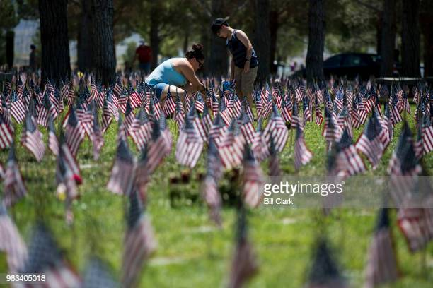 Families and friends paid their respects to the fallen on Memorial Day at the Southern Nevada Veterans Memorial Cemetery in Boulder City Nev on...