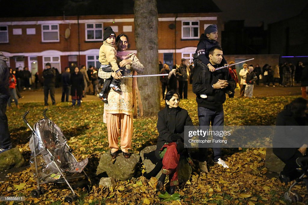 Families and locals gather to watch fireworks during the Hindu festival of Diwali on November 13, 2012 in Leicester, United Kingdom. Up to 35,000 people attended the Diwali festival of light in Leicester's Golden Mile in the heart of the city's asian community. The festival is an opportunity for Hindus to honour Lakshmi, the goddess of wealth and other gods. Leicester's celebrations are one of the biggest in the world outside India. Sikhs and Jains also celebrate Diwali.