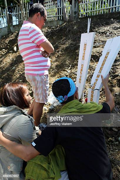 Families and relatives of massacre victims offer flowers and light candles at the site where five years ago 58 people 32 of them journalists were...