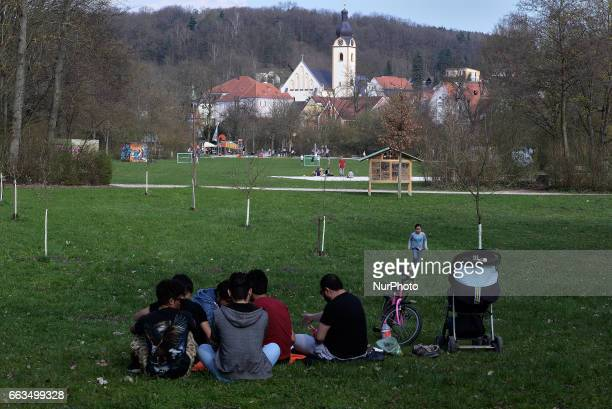 Families and several circles of friends refugees from different origins enjoying the weekend in the city park of Schwandorf Bavaria on 1st April 2017