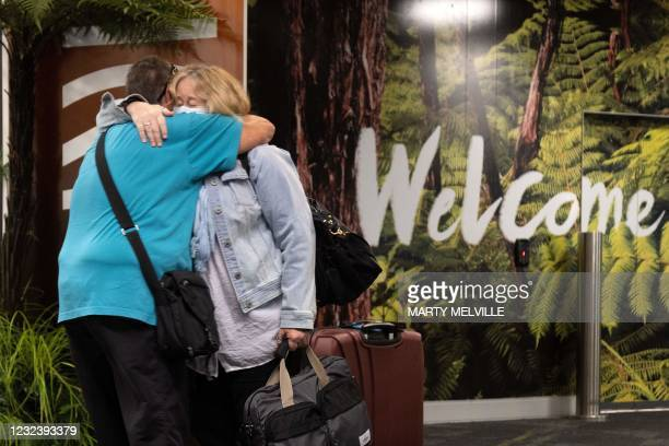 Families are reunited as travellers arrive on the first flight from Sydney, in Wellington on April 19 as Australia and New Zealand opened a...