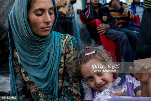 Families arrive at IDP camps from the city of Hawija and surrounding villages with support of Peshmarga on September 27 2017 in the Dibis District in...