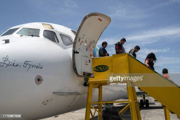 Families arrive on an ICE deportation flight from Brownsville, Texas on August 29, 2019 to Guatemala City. Under a new policy, ICE has expedited...