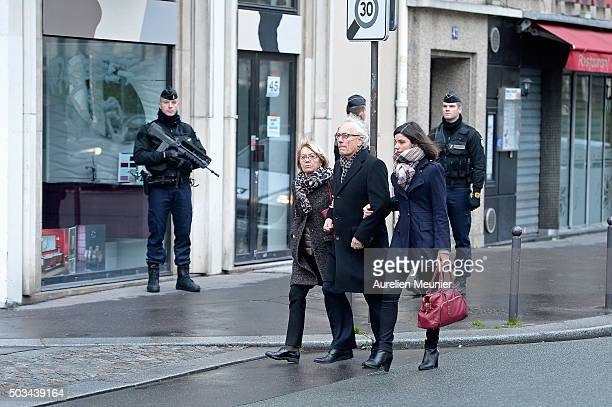 Families arrive to the inauguration of the memorial stone in front of the former Charlie Hebdo office on January 5 2016 in Paris France One year...