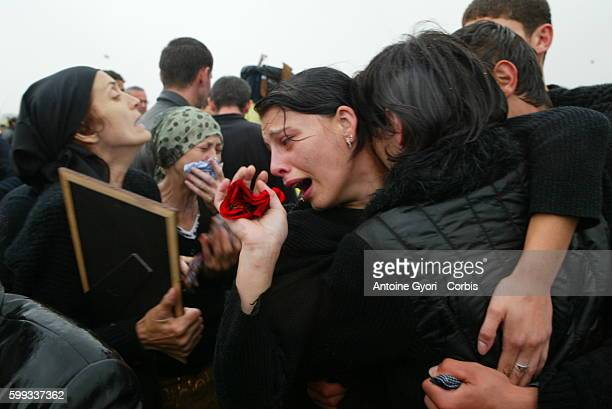 Families cry for victims of the Beslan school siege as they bury their loved ones at Vladikavkaz cemetery 318 civilians including 186 children died...